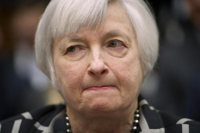 """Federal Reserve Chair Janet Yellen listens while testifying on Capitol Hill in Washington, Tuesday, Feb. 11, 2014, before the House Financial Services Committee hearing. Yellen said Tuesday that if the economy keeps improving, the Fed will take """"further measured steps"""" to reduce the support it's providing through monthly bond purchases. (AP Photo/Cliff Owen)"""