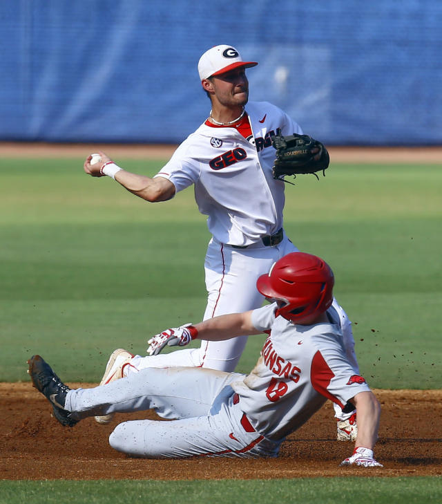 Georgia shortstop Cam Shepherd (7) throws to first after getting the force out on Arkansas' Heston Kjerstad, who slides into second base during the first inning of a Southeastern Conference tournament NCAA college baseball game, Thursday, May 23, 2019, in Hoover, Ala. (AP Photo/Butch Dill)