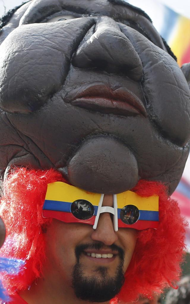 An Ecuador fan celebrates in front of the Arena Baixada soccer stadium, before their match against Honduras, in Curitiba June 20, 2014. REUTERS/Amr Abdallah Dalsh (BRAZIL - Tags: SOCCER SPORT WORLD CUP)