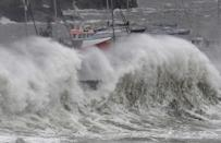 Devon didn't escape the storm, which saw large waves crash over the seawall in Brixham. (Reuters)