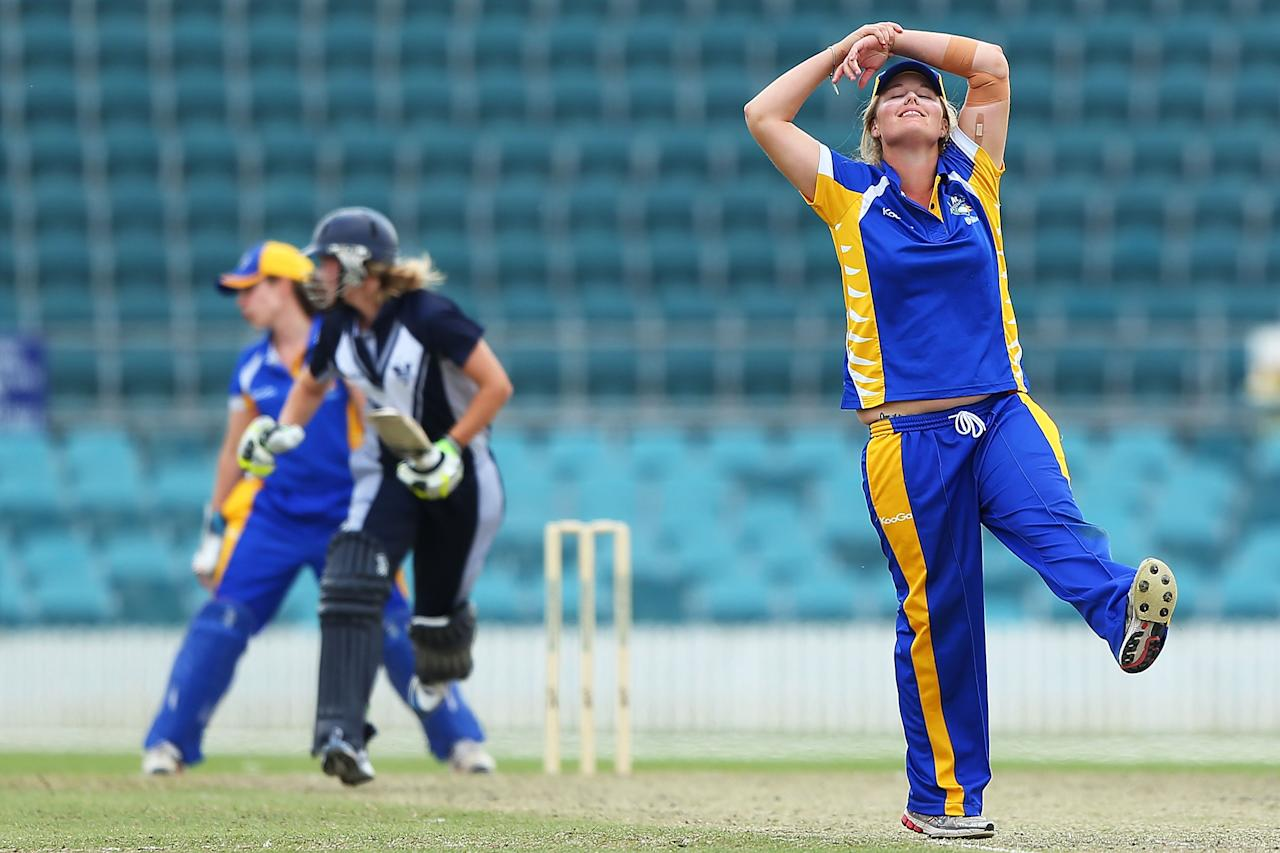 CANBERRA, AUSTRALIA - NOVEMBER 10:  Rhiannon Dick of the Meteors gestures after a close appeal during the WNCL match between the ACT Meteors and the Victoria Spirit at Manuka Oval on November 10, 2012 in Canberra, Australia.  (Photo by Brendon Thorne/Getty Images)