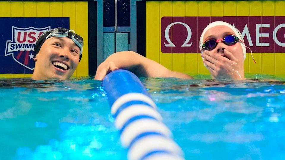 Torri Huske and Claire Curzan, right, check their times after competing in the women's 100-meter Butterfly final of the U.S. Olympic Swim Trials on Monday in Omaha. Curzan, a high school student from Cary, N.C. qualified for the Olympic team with her finish.