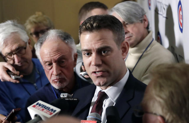 FILE - In this Jan. 12, 2018, file photo, Chicago Cubs president of baseball operations Theo Epstein, right, talks to reporters during the Cubs' annual baseball convention in Chicago. The idea of Manny Machado joining Kris Bryant and Anthony Rizzo in a powerhouse lineup sure is a tantalizing one. Whether that happens or not, the Chicago Cubs are banking on the players they have to perform up to expectations. So far, that hasn't happened. And if fans are frustrated, president of baseball operations Theo Epstein understands. (AP Photo/Charles Rex Arbogast, File)