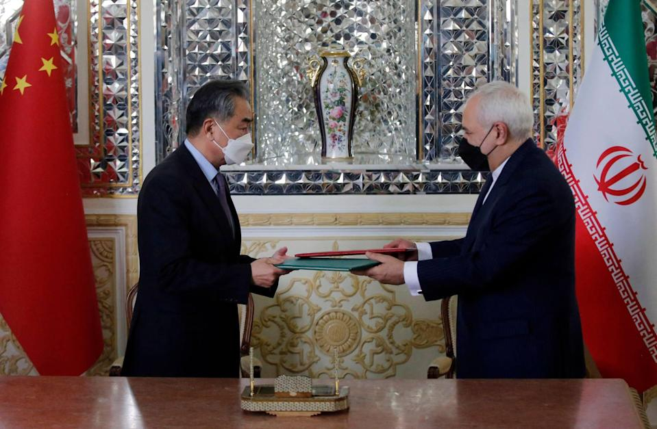 Iranian Foreign Minister Mohammad Javad Zarif and his Chinese counterpart Wang Yi, signed the deal in Tehran. Photo: AFP