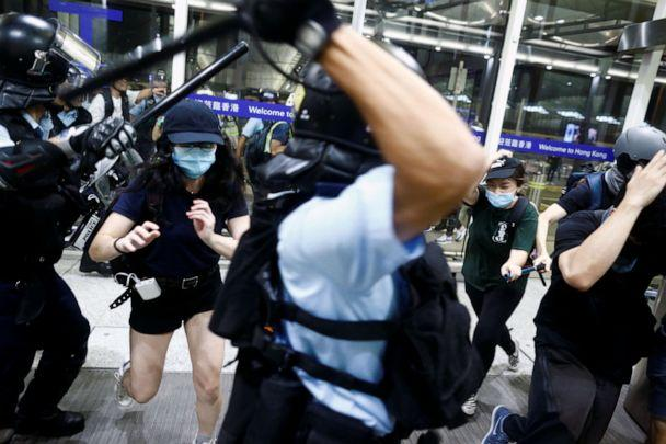 PHOTO: Police clash with protesters at the airport in Hong Kong, Aug. 13, 2019. (Thomas Peter/Reuters)