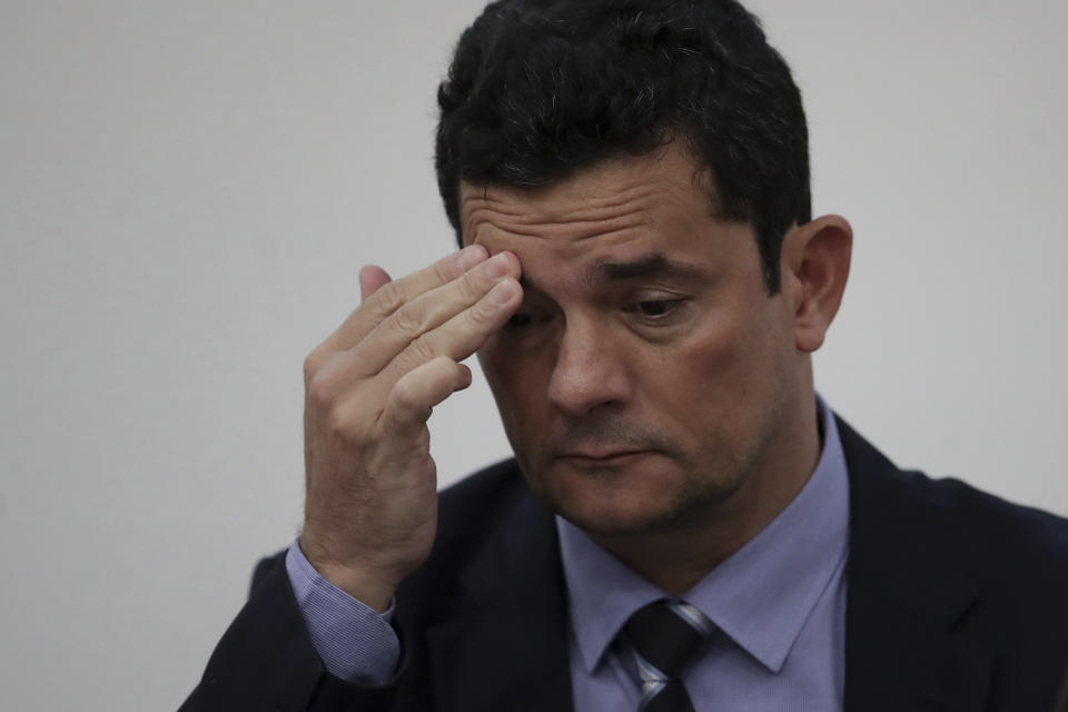 """Brazil's Justice Minister Sergio Moro touches his brow during the opening ceremony of the seminar """"Dialogue Brazil - France,"""" in the ministry headquarters in Brasilia, Brazil, Tuesday, May 14, 2019. (AP Photo/Eraldo Peres)"""