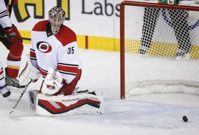 Carolina Hurricanes goalie Justin Peters reacts after a Calgary Flames goal during the second period of an NHL hockey game, Thursday, Dec. 12, 2013 in Calgary, Alberta. (AP Photo/The Canadian Press, Jeff McIntosh)