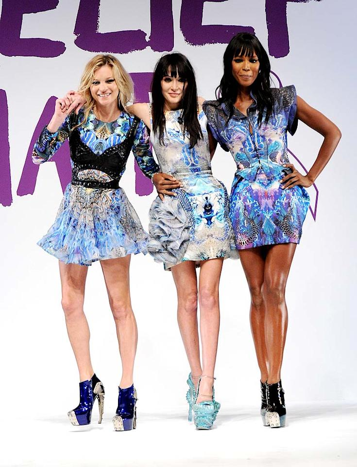"""Wearing print dresses from Alexander McQueen's spring 2010 collection, Kate Moss and Naomi Campbell, with McQueen's muse Annabelle Neilson, paid tribute to the designer, who hanged himself last Thursday, at the Fashion For Relief Haiti charity show during London Fashion Week. Moss was later seen brushing away tears as her McQueen dress raised £100,000 at the Haiti benefit. Jon Furniss/<a href=""""http://www.wireimage.com"""" target=""""new"""">WireImage.com</a> - February 18, 2010"""