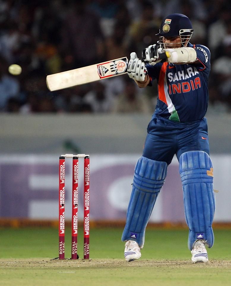 HYDERABAD, INDIA - NOVEMBER 05:  Sachin Tendulkar of India cuts the ball behind square during the fifth One Day International match between India and Australia at Rajiv Gandhi International Cricket Stadium on November 5, 2009 in Hyderabad, India.  (Photo by Mark Kolbe/Getty Images)