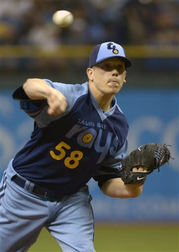 Tampa Bay Rays starting pitcher Jeremy Hellickson throws to home plate during the first inning of a baseball game against the Detroit Tigers in St. Petersburg, Fla., Saturday, June 30, 2012. (AP Photo/Phelan M. Ebenhack)