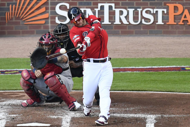 Atlanta Braves third baseman Josh Donaldson (20) follows through after hiting an RBI single against the St. Louis Cardinals in the first inning during Game 2 of a best-of-five National League Division Series, Friday, Oct. 4, 2019, in Atlanta. (AP Photo/Scott Cunningham)