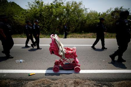 FILE PHOTO: A stroller abandoned by Central American migrants is seen after an immigration raid in their journey towards the United States, in Pijijiapan, Mexico April 22, 2019. REUTERS/Jose Cabezas/File Photo