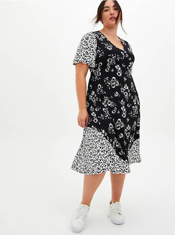 """Anti-brightness people who secretly believe love is dead, this one's for you. $76, Torrid. <a href=""""https://www.torrid.com/product/black-white-floral-studio-knit-skater-midi-dress/14588039.html"""" rel=""""nofollow noopener"""" target=""""_blank"""" data-ylk=""""slk:Get it now!"""" class=""""link rapid-noclick-resp"""">Get it now!</a>"""
