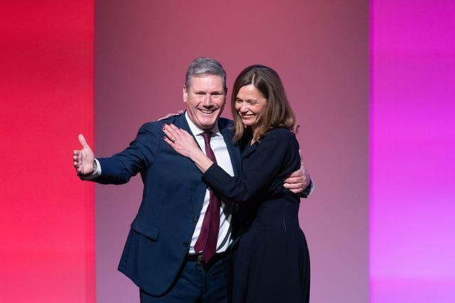 Labour leader Sir Keir Starmer is joined by his wife Victoria on stage after delivering his keynote speech to the Labour Party conference in Brighton