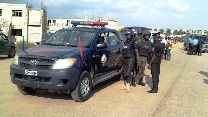 Police patrol in the northern Nigerian city of Kano, on September 17, 2014 (AFP Photo/Aminu Abubakar)