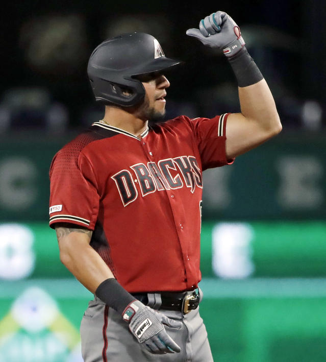 Arizona Diamondbacks' David Peralta celebrates on second base after driving in two runs with a double off Pittsburgh Pirates relief pitcher Nick Kingham during the seventh inning of a baseball game in Pittsburgh, Wednesday, April 24, 2019. (AP Photo/Gene J. Puskar)