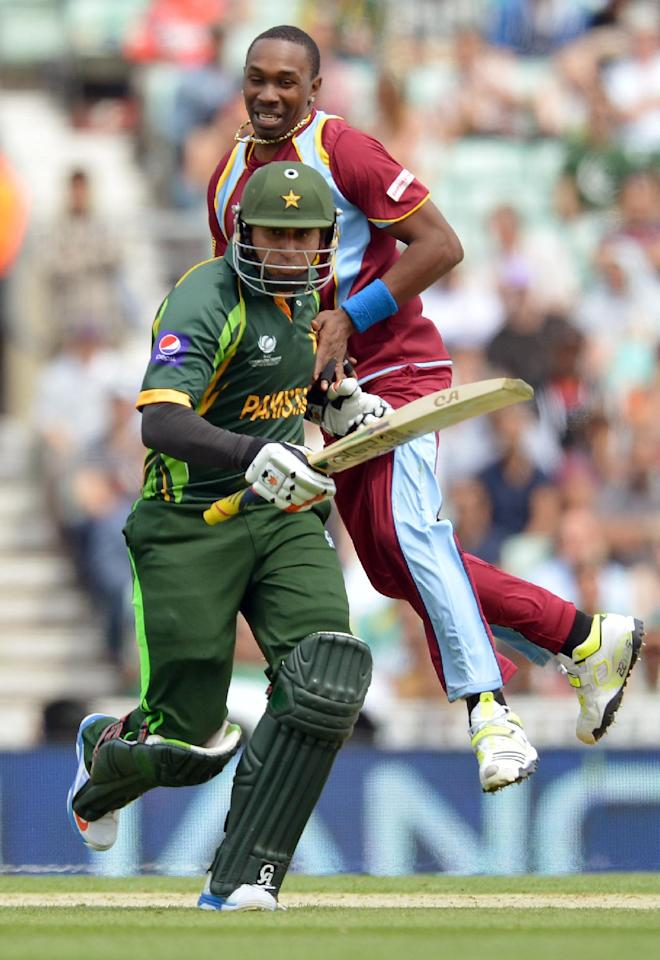 West Indies Tino Best (right) collides with Pakistan's Nasir Jamshed during the ICC Champions Trophy match at The Oval, London.