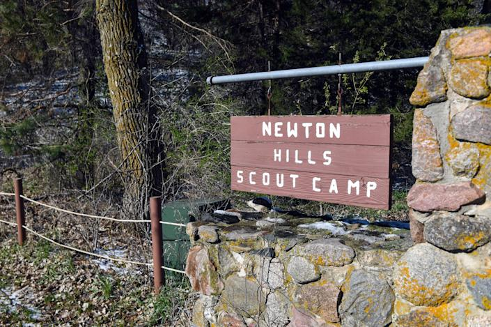 A sign for the Newton Hills Scout Camp hangs next to the gated entrance on Wednesday, April 21, 2021, in Canton.