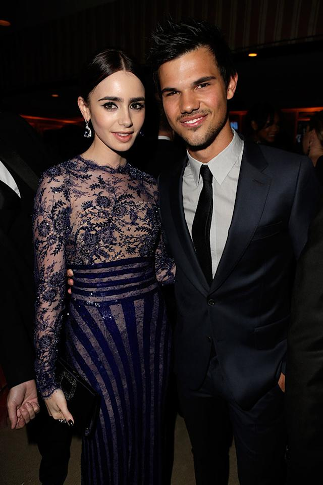 Lily Collins and Taylor Lautner attend the 2013 Vanity Fair Oscar Party hosted by Graydon Carter at Sunset Tower on February 24, 2013 in West Hollywood, California.