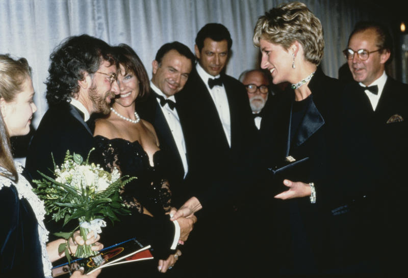 Diana, Princess of Wales (1961 - 1997) attends the premiere of the Steven Spielberg film 'Jurassic Park' in London, 15th July 1993. From left to right, she is meeting star Ariana Richards, director Spielberg and his wife Kate Capshaw, and stars Sam Neill, Jeff Goldblum and Richard Attenborough. (Photo by Princess Diana Archive/Getty Images)
