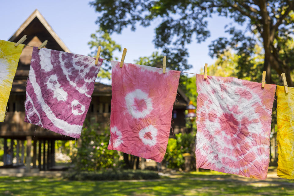 You can tie-dye everything from fabric scraps and towels to shirts, pants, sheets and more. (Photo: Getty)