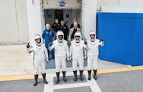 NASA astronauts Shannon Walker (L), Victor Glover (2nd L), Mike Hopkins (2nd R) and Japan Aerospace Exploration Agency (JAXA) astronaut Soichi Noguchi (R), are pictured wearing SpaceX spacesuits in a dress rehearsal ahead of the Crew Dragon launch