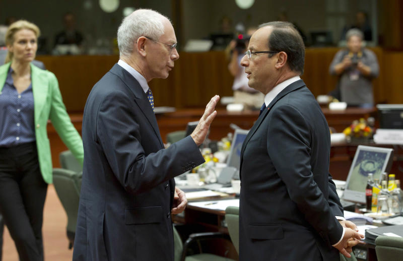 European Council President Herman Van Rompuy, center left, speaks with French President Francois Hollande during a round table meeting at an EU summit in Brussels on Friday, Oct. 19, 2012. European leaders have taken a step towards the creation of a single supervisor for banks in countries that use the euro but details over when it will be up and running have yet to be ironed out. (AP Photo/Yves Logghe)