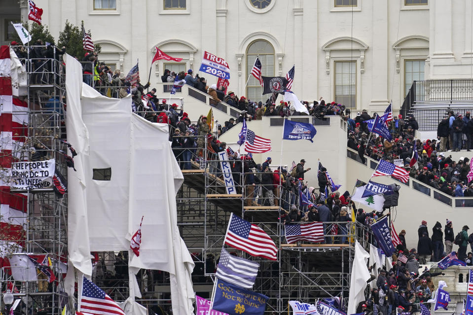 FILE - In this Jan. 6, 2021, file photo rioters loyal to President Donald Trump storm the U.S. Capitol in Washington. Arguments begin Tuesday, Feb. 9, in the impeachment trial of Donald Trump on allegations that he incited the violent mob that stormed the U.S. Capitol on Jan. 6. (AP Photo/John Minchillo, File)