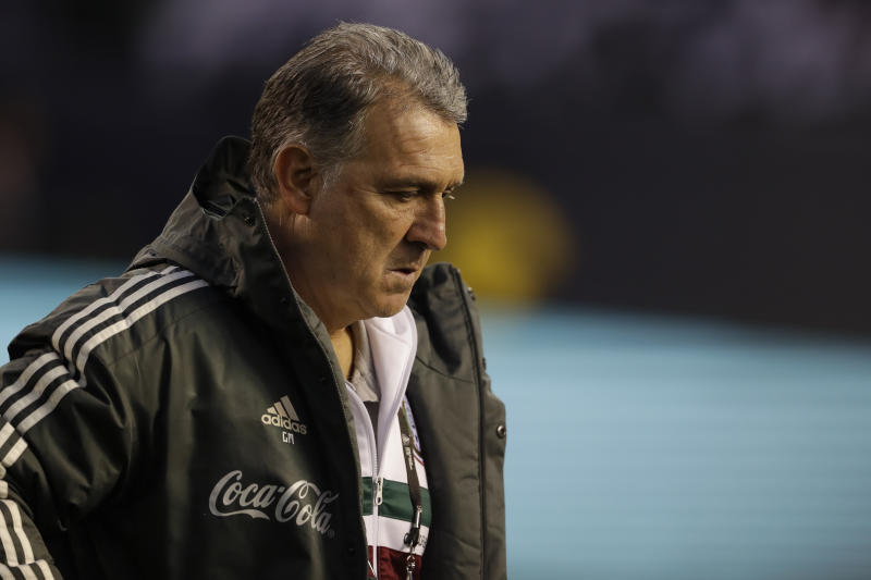 Mexico's head coach Gerardo Martino looks on before an international friendly soccer match against Chile, Friday, March 22, 2019, in San Diego. (AP Photo/Gregory Bull)
