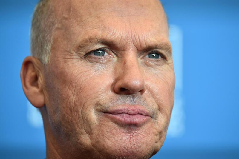 """US actor Michael Keaton poses during the photocall of the movie """"Birdman or the Unexpected Virtue of Ignorance"""" presented in competition on the opening day of the 71st Venice Film Festival on August 27, 2014 at Venice Lido"""
