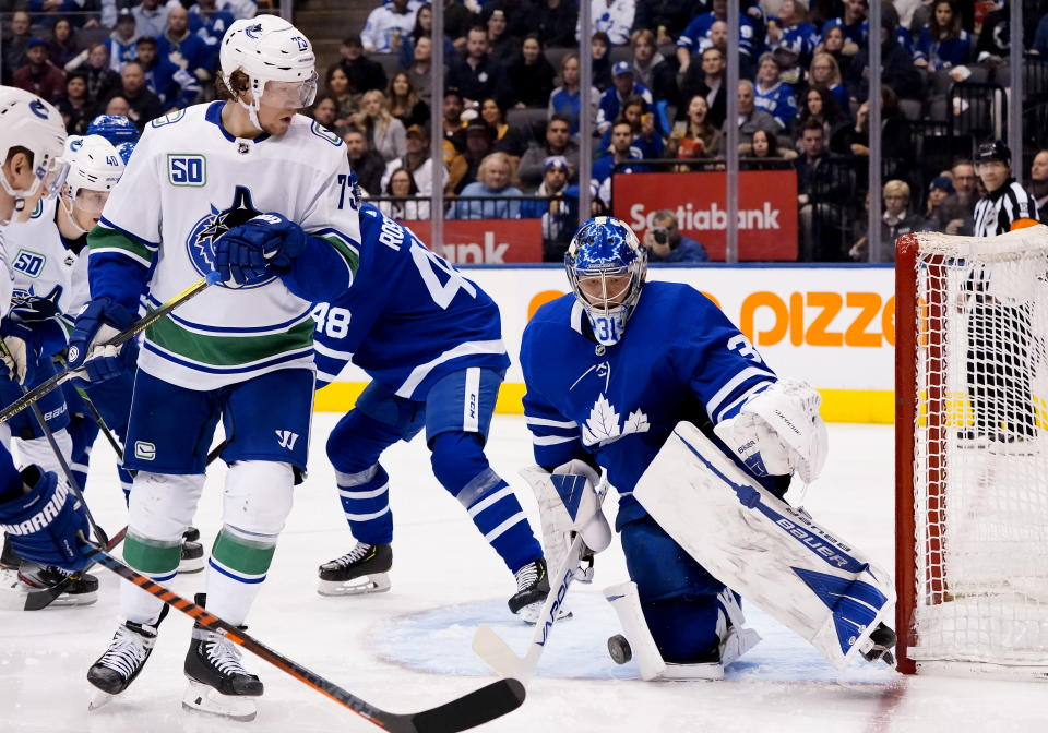 Toronto Maple Leafs goaltender Frederik Andersen (31) makes a save as Vancouver Canucks right wing Tyler Toffoli (73) looks on during third-period NHL hockey game action in Toronto, Saturday, Feb. 29, 2020. (Frank Gunn/The Canadian Press via AP)