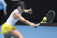 China's Zheng Saisai makes a backhand return to Japan's Naomi Osaka during their second round singles match at the Australian Open tennis championship in Melbourne, Australia, Wednesday, Jan. 22, 2020. (AP Photo/Andy Brownbill)