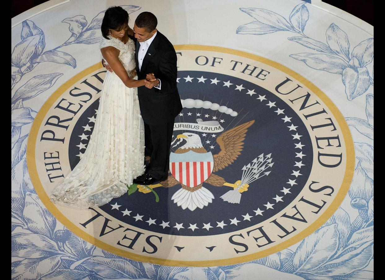 US President Barack Obama and First Lady Michelle Obama dance during the Commander-in-Chief Ball at the National Building Museum in Washington, DC, January 20, 2009. Obama was sworn in as the 44th US president earlier in the day. AFP PHOTO / Saul LOEB (Photo credit should read SAUL LOEB/AFP/Getty Images)