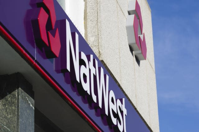 Natwest signs and logo on a high street bank building.