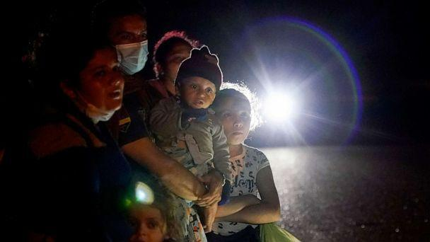PHOTO: A group of migrants mainly from Honduras and Nicaragua wait along a road after turning themselves in upon crossing the U.S.-Mexico border, in La Joya, Texas, May 17, 2021. (Gregory Bull/AP, FILE)
