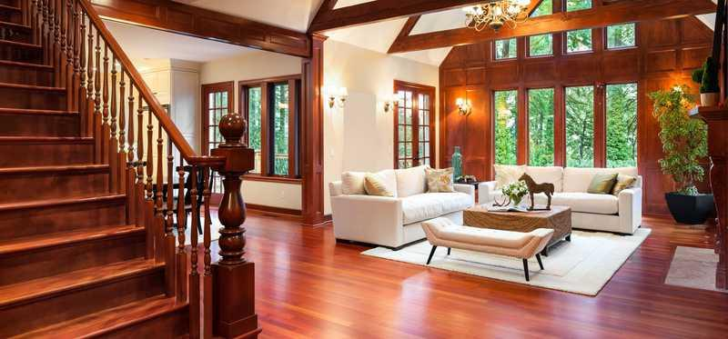 A home interior with rich wood and large windows