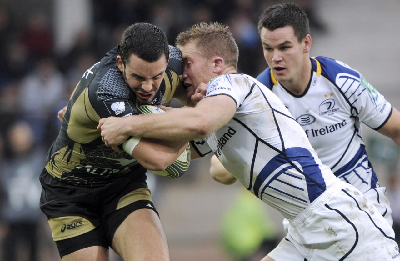 Montpellier's Geoffrey Doumayrou (L) vies with Leinster's Luke Fitzgerald (R) during the Heineken Cup rugby union match Montpellier vs Leinster on November 12, 2011 at the Mosson stadium in Montpellier. AFP PHOTO / ANNE-CHRISTINE POUJOULAT (Photo credit should read ANNE-CHRISTINE POUJOULAT/AFP/Getty Images)