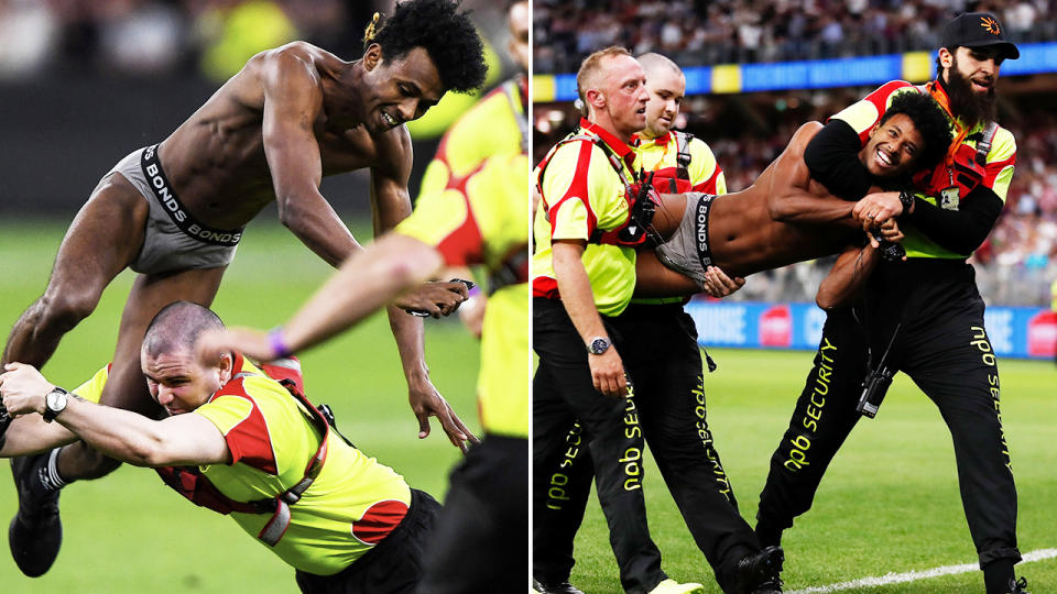 Abra Bol, pictured here being taken down by security guards after running into the field during the AFL grand final.