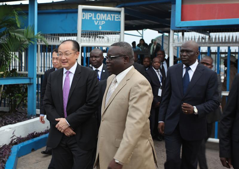 World Bank President Dr. Jim Yong Kim, left, is greeted by Congolese officials as he arrives in Kinshasa, Congo, Wednesday, May 22, 2013. Along with U.N. Secretary-General Ban Ki-moon, Kim will be visiting Kinshasa and eastern Congo as part of a regional tour. (AP Photo/John Bompengo)