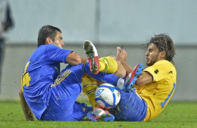 Ukraine's Ievgenii Shakhov (L) collides with Sweden's Astrit Ajdarevic during the U21 European Football Championships qualification match in Kalmar on September 10, 2012. AFP PHOTO/SCANPIX/ Patric SoderstromPatric Soderstrom/AFP/GettyImages