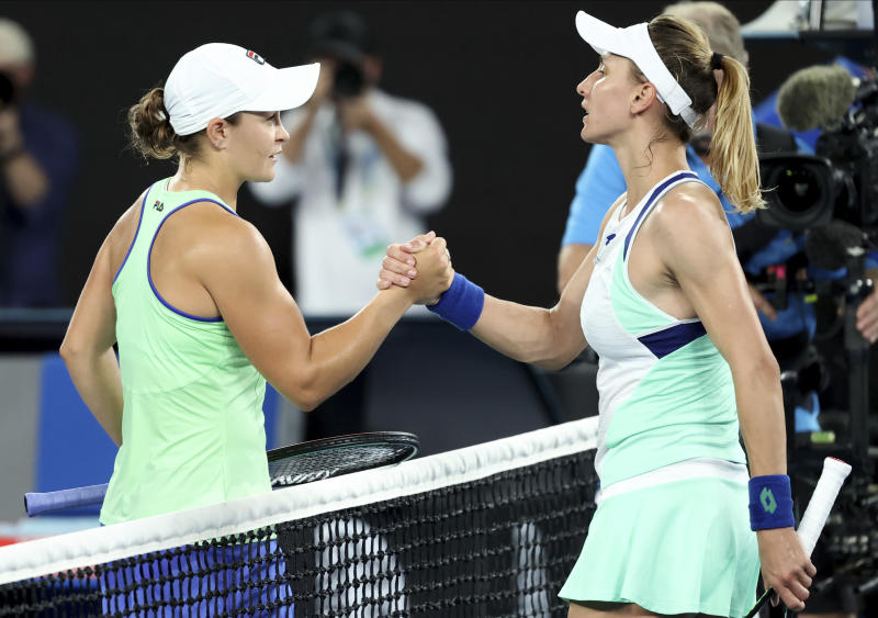 Australia's Ashleigh Barty, left, is congratulated by Lesia Tsurenko of Ukraine after winning their first round singles match at the Australian Open tennis championship in Melbourne, Australia, Monday, Jan. 20, 2020. (AP Photo/Lee Jin-man)