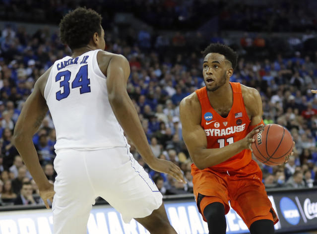 Syracuse's Oshae Brissett, right, heads to the basket as Duke's Wendell Carter Jr (34) defends during the second half of a regional semifinal game in the NCAA men's college basketball tournament Friday, March 23, 2018, in Omaha, Neb. (AP Photo/Charlie Neibergall)