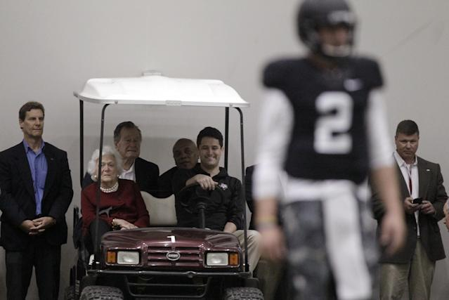 Former President George H.W. Bush and Barbara Bush, watch Texas A&M quarterback Johnny Manziel (2) during pro day for NFL football representatives in College Station, Texas, Thursday, March 27, 2014. (AP Photo/Patric Schneider)
