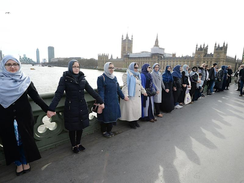 The women, some of whom said they were wearing blue as a symbol of hope, held hands for five minutes (PA)