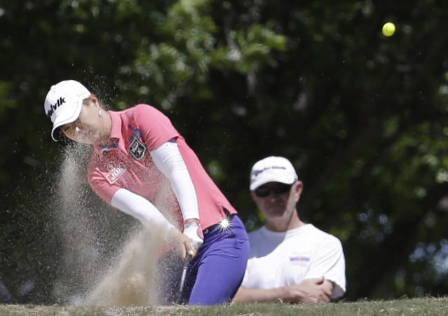 Menna Lee, of South Korea, hits from the bunker on the first hole during the final round of the North Texas LPGA Shootout golf tournament at Las Colinas Country Club in Irving, Texas, Sunday, May 4, 2014. (AP Photo/LM Otero)