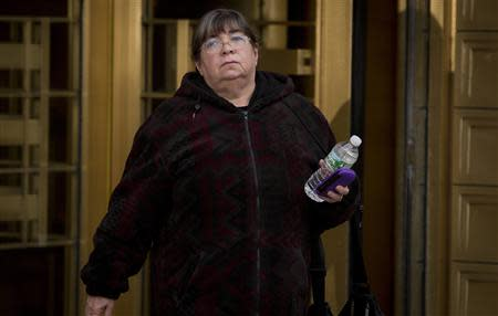 Bernie Madoff's former secretary, Annette Bongiorno departs Manhattan Federal Court in the Manhattan Borough of New York