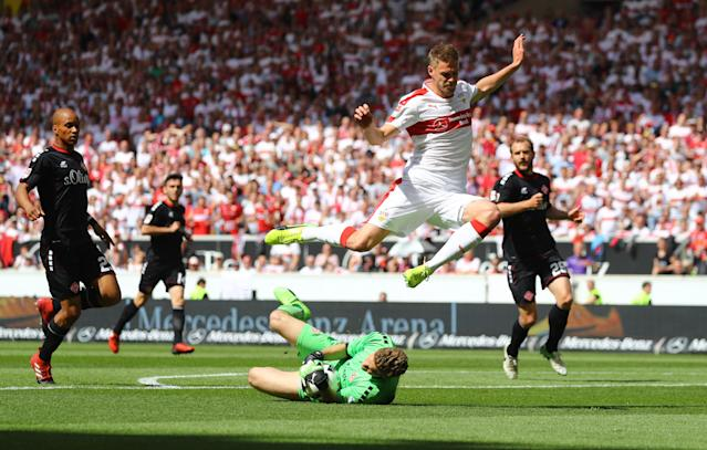 Football Soccer - VfB Stuttgart v Wurzburger Kickers - 2. Bundesliga - Mercedes-Benz Arena, Stuttgart, Germany - 21/5/17 VfB Stuttgart's Simon Terodde in action with Wurzburger Kickers' Jorg Siebenhandl Reuters / Kai Pfaffenbach Livepic DFL RULES TO LIMIT THE ONLINE USAGE DURING MATCH TIME TO 15 PICTURES PER GAME. IMAGE SEQUENCES TO SIMULATE VIDEO IS NOT ALLOWED AT ANY TIME. FOR FURTHER QUERIES PLEASE CONTACT DFL DIRECTLY AT + 49 69 650050.