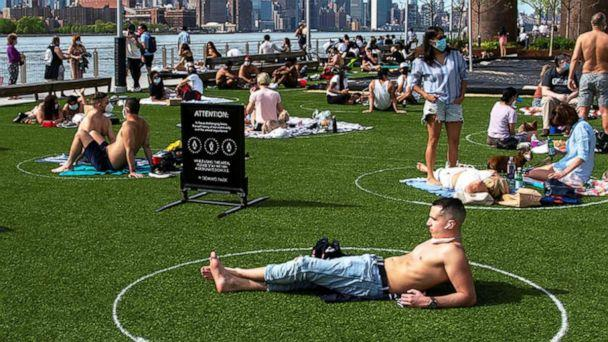 PHOTO: People try to keep social distance as they enjoy a warm afternoon at Domino Park in Brooklyn, New York, May 16, 2020. (Eduardo Munoz/Reuters, FILE)