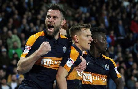Newcastle United's Matt Ritchie celebrates scoring their first goal with Daryl Murphy