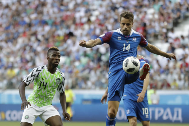 Iceland's Kari Arnason, right, challenge for the ball with Nigeria's Kelechi Iheanacho during the group D match between Nigeria and Iceland at the 2018 soccer World Cup in the Volgograd Arena in Volgograd, Russia, Friday, June 22, 2018. (AP Photo/Andrew Medichini)